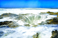 Thor's well on a bright day and high tide.