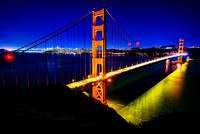 Golden Gate Bridge and San Francisco glowind at night.