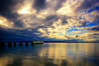 A ferry and some afternoon drama in sky, from Edmonds Beach